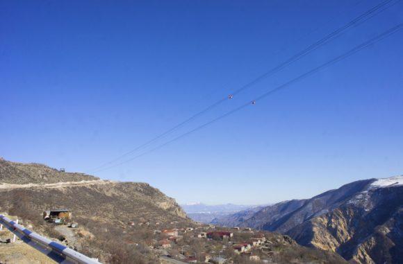 380 метров до дна ущелья, 5,7 км в длинну над живописным ущельем реки Воротан.